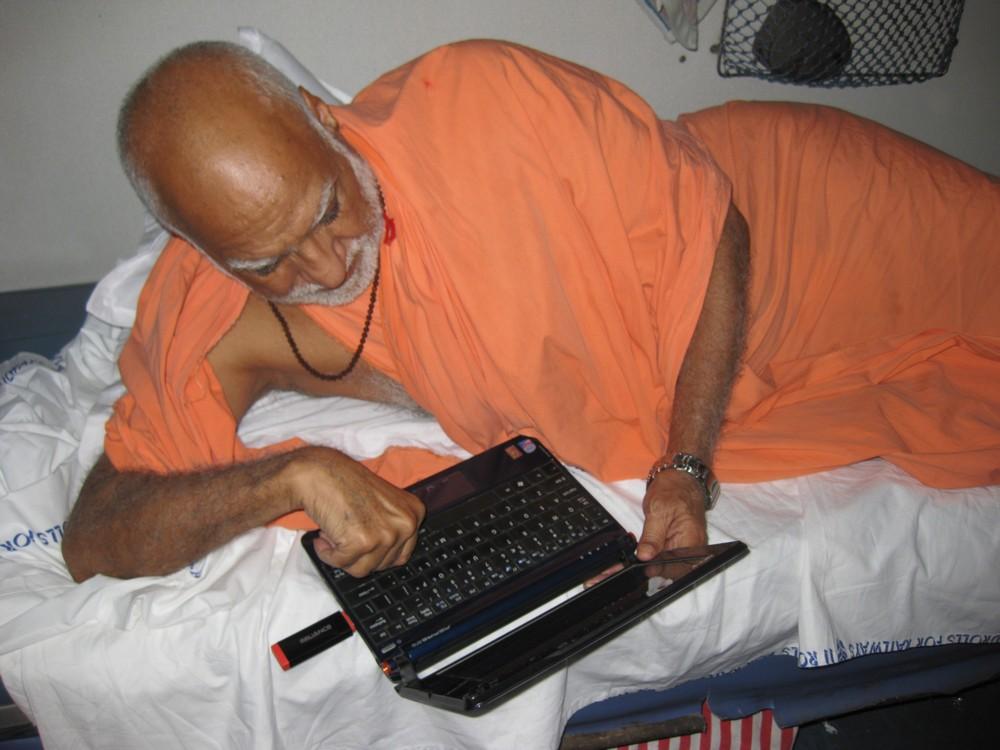 10th June. On board to Kochi. Maharaj Ji reading updates on Baba Ramdev\'s fast.