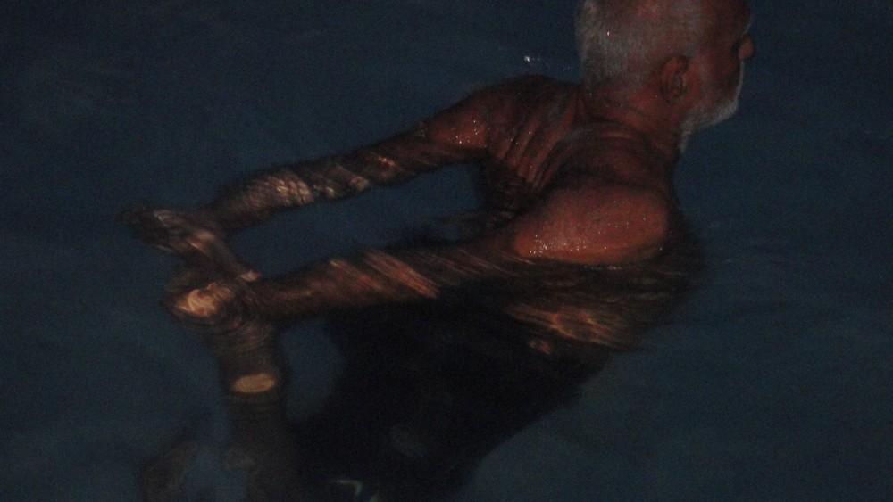 11th June. Late Evening. Maharaj Ji practicing a yogic mudra at the swimming pool in Kochi