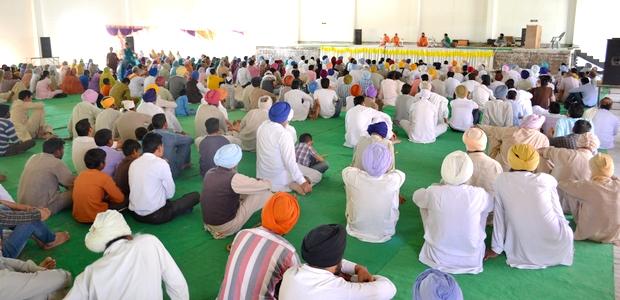 Devotees listening to Swami Buddh Puri Ji Maharaj on Barsi of Bhagat Jagat Singh Ji