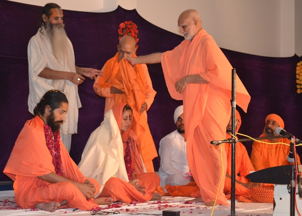 Maharaj Ji instating Swami Suryendu Puri Ji and Sadhwi Yoganjali Chaitanyaa Puri Ji as his successors during the Tripur Shiva Peetham Inauguration ceremony held on October 3, 2014 at Shabad Surati Sangam Ashram.