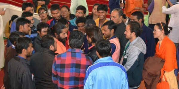Swamiji's lecture at the Main Hall on March 5 made a sound impression on the minds of the audience, especially students. Seen above are some yoga students conversing freely with Swamiji after his talk.