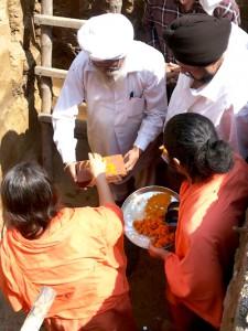 Sadhvi Ji and Swami Ji placing the foundation stone for Samadhi Mandir