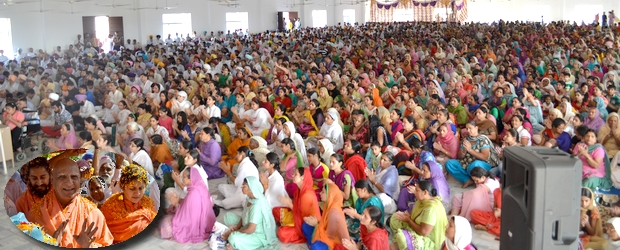 Devotees in rapt attention, making the most of SHri Maharaj Ji's presence in person.